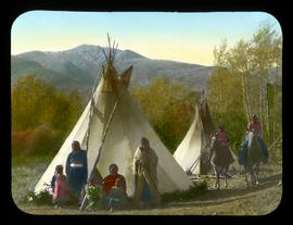 [Unidentified women and children in front of teepees, Kootenay Plains]