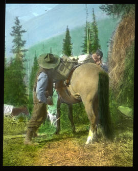 [Jim Simpson & unidentified man packing a horse]