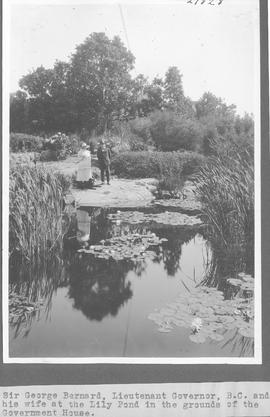 Sir George Barnard, Lieutenant Governor, B. C., and his wife at the Lily Pond in the grounds of t...