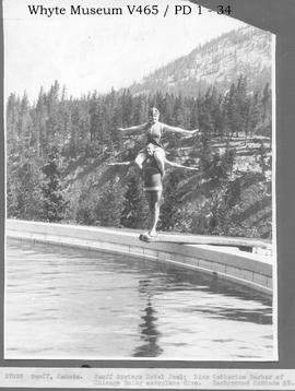 Banff, Canada. Banff Springs Hotel Pool. Miss Catherine Barber of Chicago doing aeroplane dive. B...